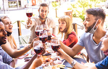 Friends Toasting Red Wine At R...