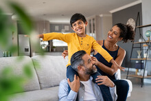 Happy Son Playing With Parents At Home