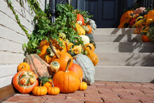 Pumpkins And Gourds In Front Of A Porch In Autumn
