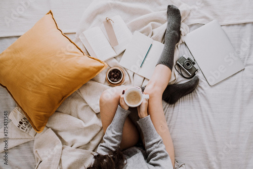 Fotografija Enjoying delicious coffee and breakfast while working in bed
