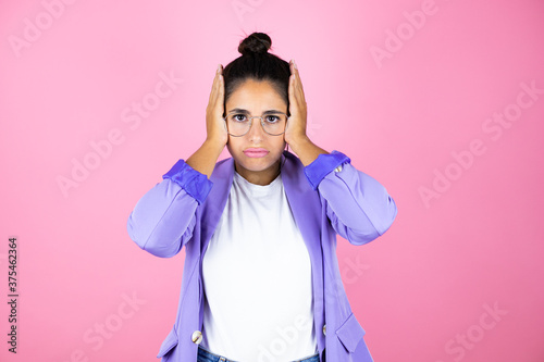 Obraz Young beautiful business woman over isolated pink background thinking looking tired and bored with hands on head - fototapety do salonu