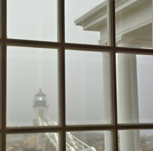 Foggy Day At Marshall Point In Port Clyde Maine. Historic Marshall Point Light And Walkway Viewed From Window Inside Lighthouse.