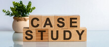 Case Study Word Written On Wood Block. Case Study Text On Table, Concept. Front View Concepts, Flower In The Background