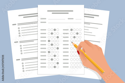 Valokuvatapetti The student filling out answers to exam test answer sheet with a pencil