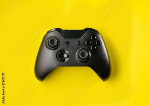 Top view Black controller on yellow background Canvas Print