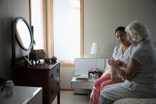 Home Caregiver Showing Prescri...