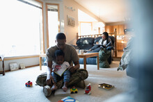 Soldier Father And Toddler Son...