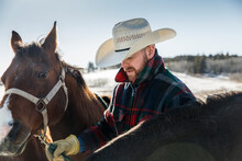 Male Rancher With Horse On Sun...