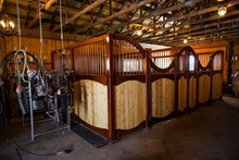 Equipment And Wooden Stalls In Stable Barn