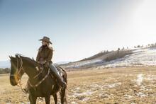Female Rancher Horseback Ridin...