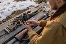 Male Hunter With Bullet Prepar...