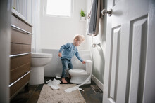 Boy Flushing Toilet After Use
