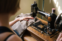 Young Woman Using Vintage Sewi...