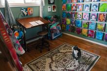 Art Studio With Cat On Rug