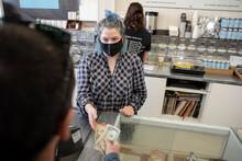 Customer Paying Female Barista...