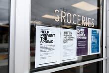 Coronavirus Public Health Notices On Grocery Store Window