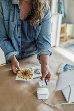 Female Artist With Mosaics Using Contactless Credit Card Swiper