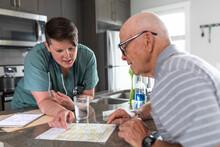 Home Caregiver Explaining Test...