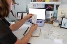 Artist Checking Her Receipts U...