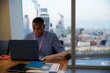 Focused Businessman Working At...