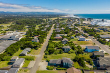 Aerial Of Houses And Vacation Homes In Coastal Town Of Bandon, Oregon, USA.