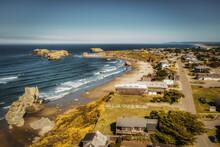 Drone Shot Of Bandon Oregon Coastal Homes Real Estate Overlooking Beach.