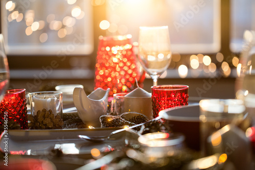 Obraz christmas, holidays and eating concept - table served for festive dinner at home - fototapety do salonu