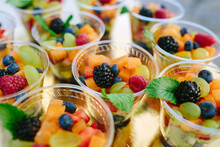 Closeup Shot Of Fresh Fruits In Plastic Cups