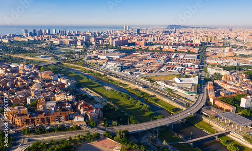 Photo Aerial panoramic view of Sant Adria de Besos and Barcelona on Besos river with M