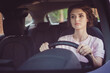 Photo of serious taxi driver girl ride drive car traffic town hurry passenger order hold steering wheel wear summer t-shirt outfit