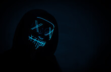 Portrait Of An Anonymous Hacker In A Neon Mask, Halloween Mask