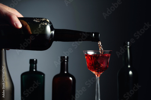Fotografie, Obraz Aged golden fortified sherry being poured into a crystal glass.