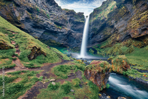 Fresh green view of Kvernufoss watterfall. Splendid summer scene of pure water river in Iceland, Europe. Beauty of nature concept background.