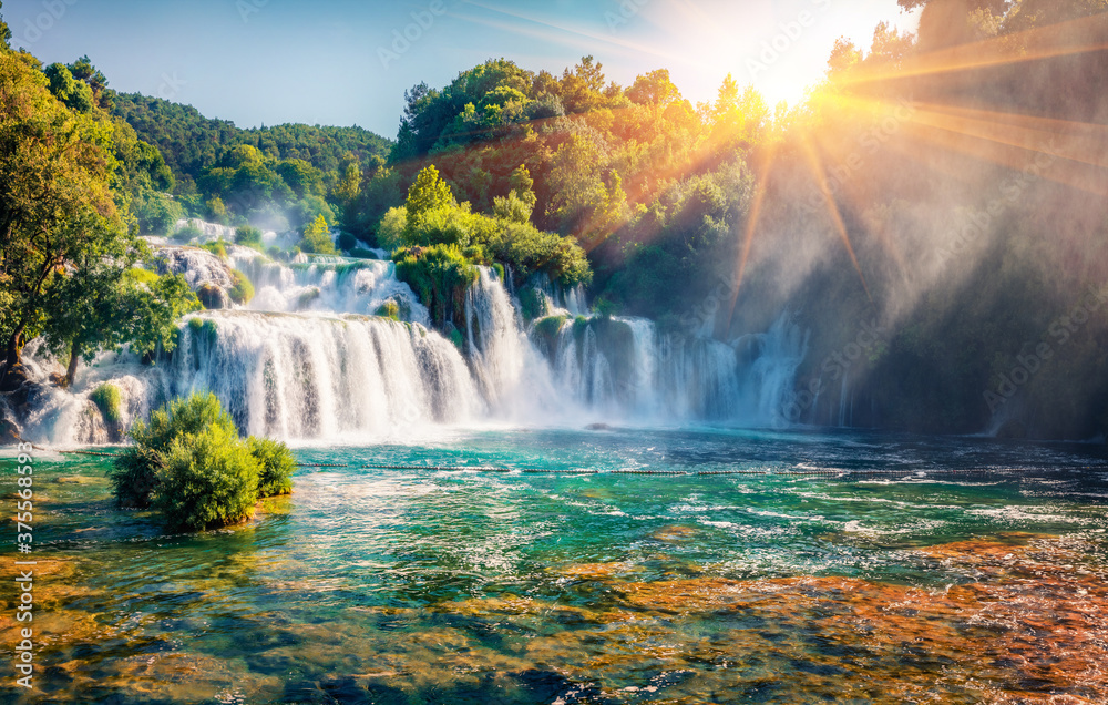 Fototapeta Captivating morning scene of Krka National Park, Lozovac village location, Croatia, Europe. Amazing  sunrise on Skradinski Buk waterfall. Beautiful world of Mediterranean countries.