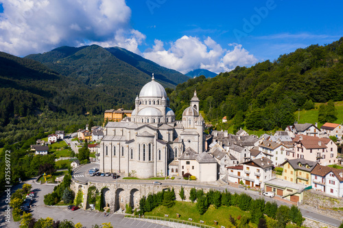 Fototapeta General view of picturesque Re village in green Italian Alps in sunny summer day