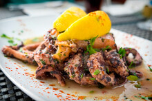 Delicious Dish From Traditonal Cuisine Of Malta Island - Freshly Caught Octopus Grilled With Garlic And Olive Oil And Served With Wine Sauce