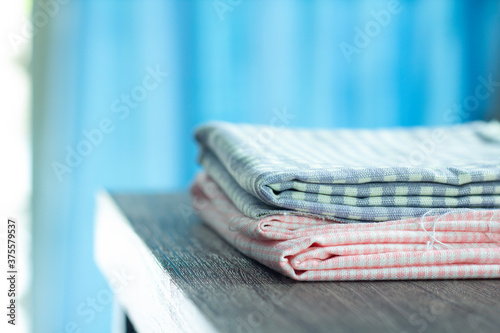 Carta da parati A close-up select focus of fabrics fold stack for the designer fashion business or for example when choosing curtains or home decor