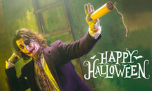 Young Man As A Joker On Green Background, Halloween Time, Flyer With Copyspace. Black Friday, Cyber Monday, Sales, Autumn Concept. Flyer For Your Ad. Halloween Mood, October Time, Scary And Stylish.
