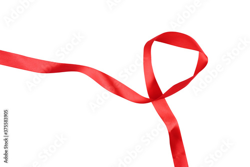 Fényképezés intertwined red ribbon separating white background