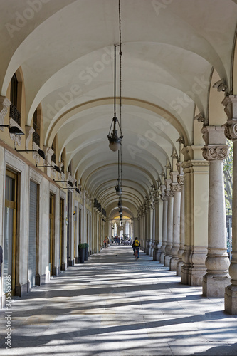 Fotografie, Obraz Colonnades along shopping arcade in the wealthy city centre of Turin