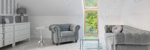 Foto Panorama of white, attic drawing room