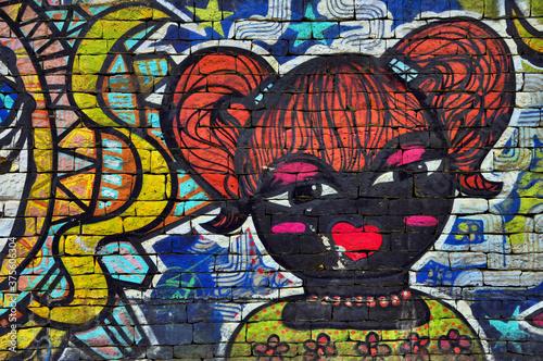 Street art, Dessin enfantin du visage d'une petite fille rousse avec des couette Canvas Print