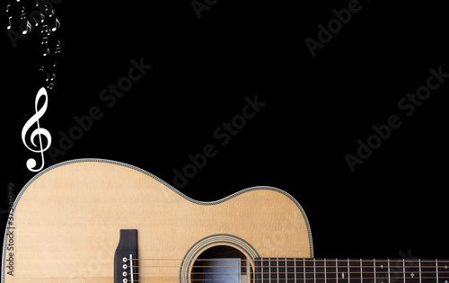 classic steel string acoustic guitar on a black background with white music nota Canvas Print