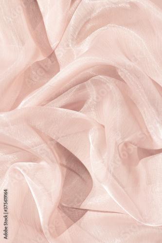 Obraz na plátně Light pink abstract satin background.