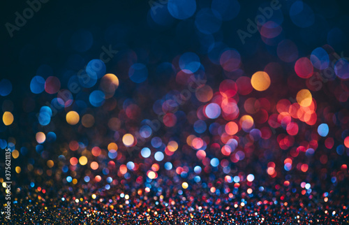 Abstract neon halftone color bokeh texture. Sparkling blur holiday light. Christmas nad new year eve blurred background.