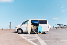 Man With Surfboards And Van