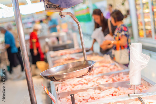 Fototapeta Electronic scale. weighing meat in supermarket.