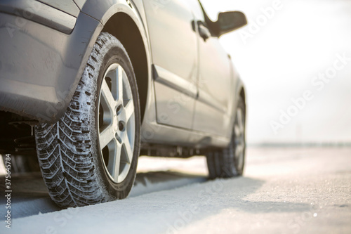 Close-up of car wheels rubber tire in deep snow Canvas