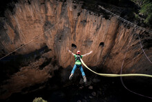 Man Doing Bungee Jumping Jumping Into The Void In Mountain Rock Adventure Adrenaline
