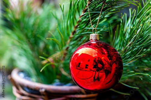 Valokuva Macro closeup of traditional one New Year decorative red apple shiny ornament ha